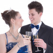 Carnival: young couple isolated on white drinking champagne — Stock Photo #38915759