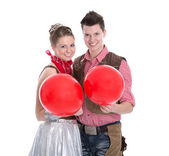 Young couple have fun in carnival time - isolated on white — Zdjęcie stockowe