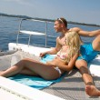 Couple on honeymoon on a sailboat — Stock Photo