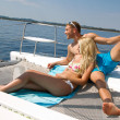 Stock Photo: Couple on honeymoon on a sailboat