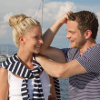 Young couple in love makes holiday on a sailboat — Stock Photo