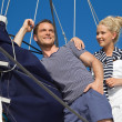 Young couple in love makes holiday on a sailboat — Stock Photo #38925203