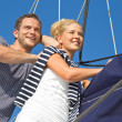 Young couple in love makes holiday on a sailboat — Stock Photo #38925217