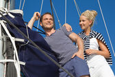 Young couple in love makes holiday on a sailboat — 图库照片