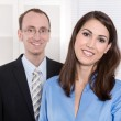 Good teamwork - business team - portrait man and woman smiling i — Stock Photo #38949331