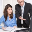 Two businesspeople in the office - discussion or bullying at wor — Stock Photo