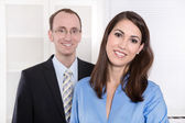 Good teamwork - business team - portrait man and woman smiling i — Stock Photo