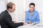 Two business people talking together at desk - adviser and custo — Foto de Stock
