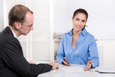 Business meeting - consulting - man and woman in the office — Stock Photo