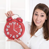 It's for a clock - young woman is happy - its leisure time — Stock Photo