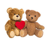Two happy teddy bears with a red heart isolated on white backgro — Stock Photo