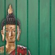 Buddha gold statue - asia decoration from Thailand on a green wo — Stock Photo