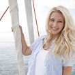 Portrait of blond beautiful young woman on sailing boat. — Stock Photo #39960145