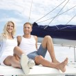 Attractive couple sitting on sailing boat - love. — Stock Photo