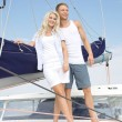 Attractive couple standing on sailing boat - sailing trip. — Stock Photo