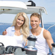Attractive couple standing on sailing boat - sailing trip. — Stock Photo #39961141