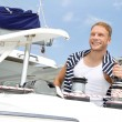Blond handsome young man on sailing boat. — Stock Photo #39961359
