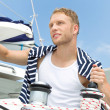 Portrait of blond handsome young man on sailing boat. — Stock Photo #39961547