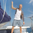 Blond handsome young man on sailing boat. — Stock Photo