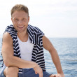Portrait of blond handsome young man on sailing boat. — Stock Photo
