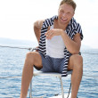 Blond handsome young man on sailing boat. — Stock Photo #39961841
