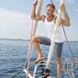 Blond handsome young man on sailing boat. — Stock Photo #39962125