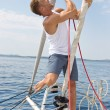 Blond handsome young man on sailing boat. — Stock Photo #39962813