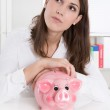 Young woman with her savings is dreaming of her next holiday — Stockfoto