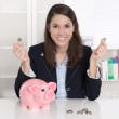 Young pretty business woman count money - coins with a piggy ban — Stockfoto