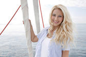 Portrait of blond beautiful young woman on sailing boat. — Stock Photo
