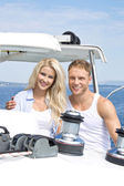 Attractive couple standing on sailing boat - sailing trip. — Photo