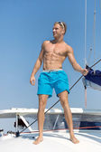 Portrait of sexy young man on sailing boat. — Stock Photo