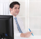 Smiling manager sitting at office - positive. — Stock Photo