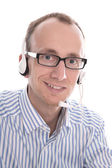 Telesales - Portrait of helpful man with headset smiling at came — Stock Photo