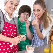 Happy family cooking together - with the grandmother — Stock Photo #40209483