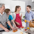 Happy family cooking together - with the grandmother. — Stock Photo #40209975