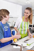 Mother cooking with her son in the kitchen - family life. — Stock Photo