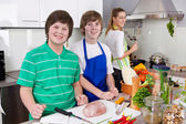 Mother cooking with her sons in the kitchen - family life. — Stock Photo