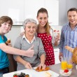Happy family cooking together - with the grandmother. — Stock Photo #40210169
