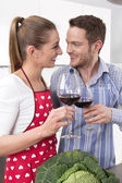 Couple in love cooking in the kitchen - drinking red wine. — Zdjęcie stockowe