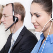 Telesales or helpdesk team with Headsets - workers at call Cente — Foto de Stock