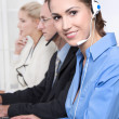 Telesales or helpdesk team - helpful woman with headset smiling — Stock Photo #40244337