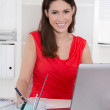 Attractive secretary in front of her computer at office. — Stock Photo #40247999