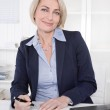 Happy senior female manager - portrait in the office. — Stock Photo #40312999