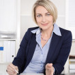 Happy senior female manager - portrait in the office. — Stock Photo