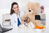 Young doctor for children with a teddy bear. — Zdjęcie stockowe
