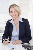 Happy senior female manager - portrait in the office. — Stockfoto