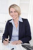 Happy senior female manager - portrait in the office. — Zdjęcie stockowe