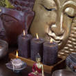Asiatic decoration in brown and gold with buddha and candles. — Stock Photo #40338709