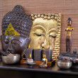 Asiatic decoration in brown and gold with buddha and candles. — Stock Photo #40338771